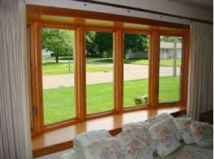 Large bay windows overlooking backyard