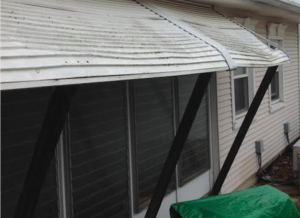 House with awning in poor condition
