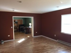 Renovated room with hardwood floors