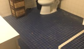 Old bathroom with tile floor
